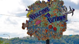 """Street art of an """"Uptown"""" sign in Pittsburgh."""
