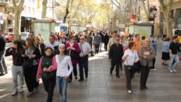 Men and women walking in Barcelona.