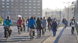 Men and women biking in Stockholm.