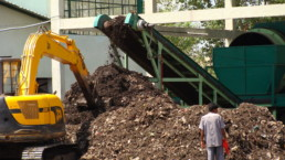 Man in New Delhi working in a compost plant.