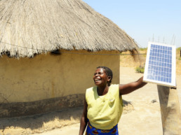 Woman using a solar panel crowdfunded. TRINE