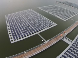 Aerial view of Singapore's solar panel farm on land and sea.