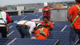 Men working and installing solar panels in Washington D.C.