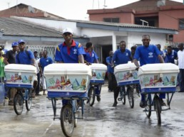 Men delivering rice on bikes in Nigeria.