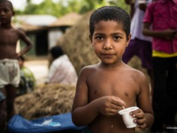 Child eating fortified yoghurt to combat malnutrition.