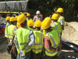 Construction workers having a meeting made to create a holistic corporate supply chain.