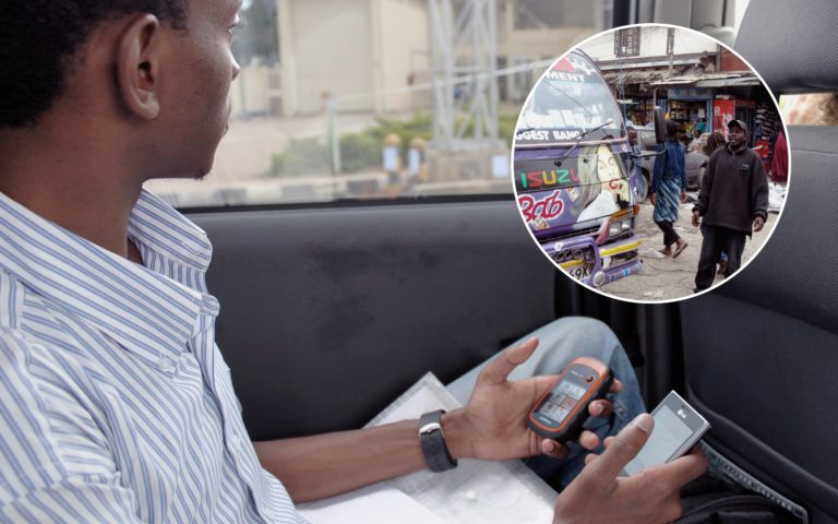 Man using his smartphone and the Digital Matatus app for public transportation services.