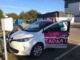 Woman in a TADAA! electric vehicle in Aarhus Municipality.