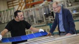 Two men looking at a new solar panel in Aarhus Kommune