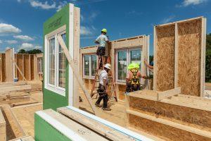 Men building homes