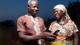 Farmers in Africa using a a phone for sms updates