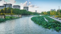 River with waterside deck and greening bank in Ningbo city
